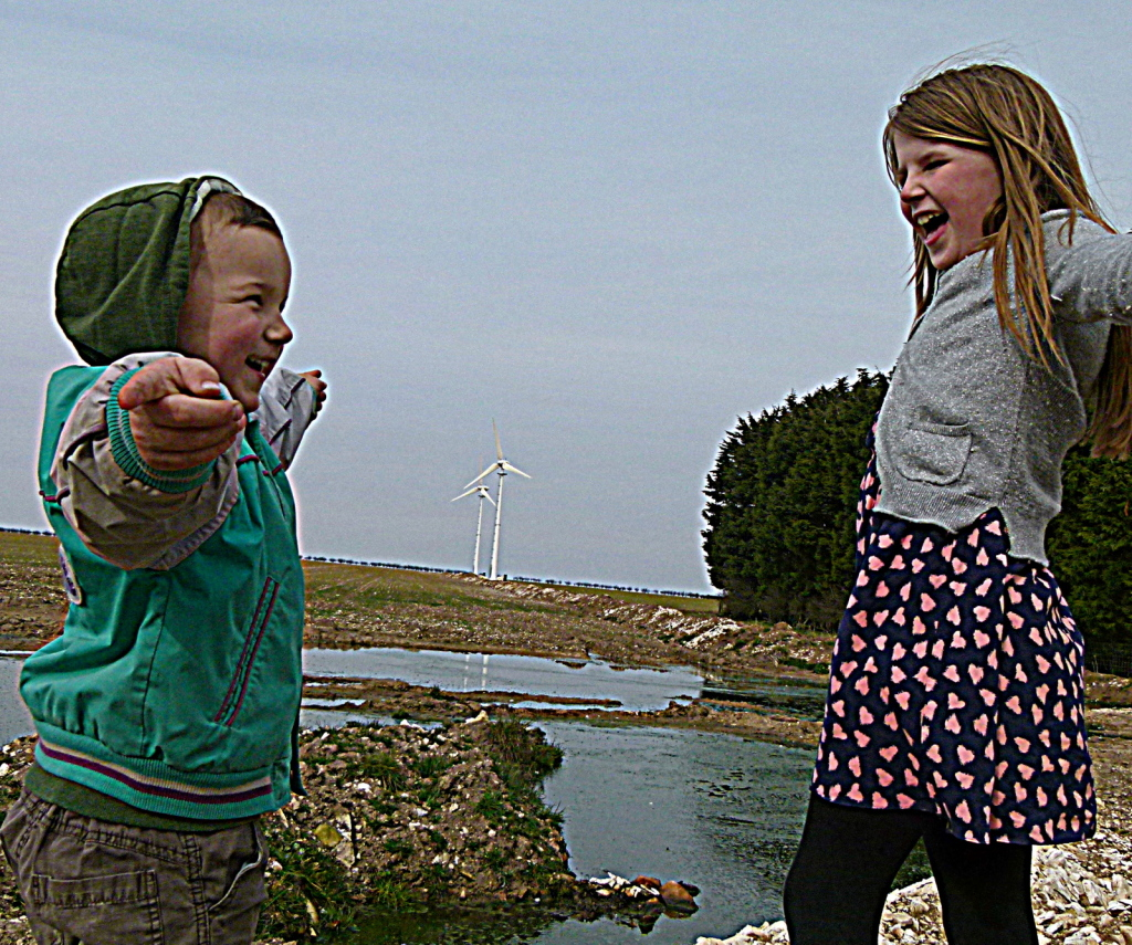 The Savile Children of Raven Hill Farm infront of their two Endurance E-3120 wind turbines